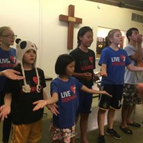 One of three youth teams practices a song.