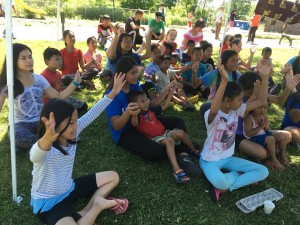 Children learned about Jesus through Bible action songs.